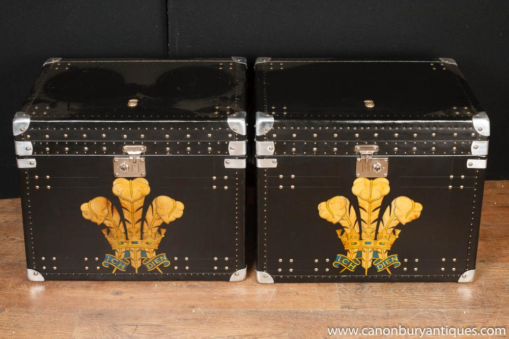 Pair steamer trunk side tables decorated with a Prince of Wales festoon