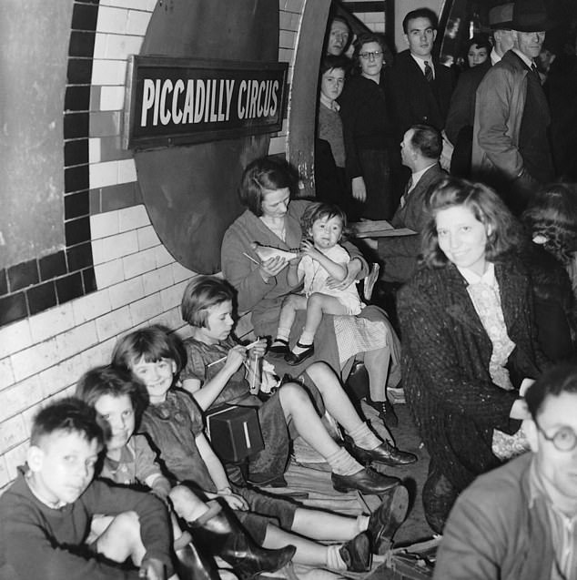Londoners sheltering at Picadilly Circus during World War II. The Blitz spirt: children still smiling