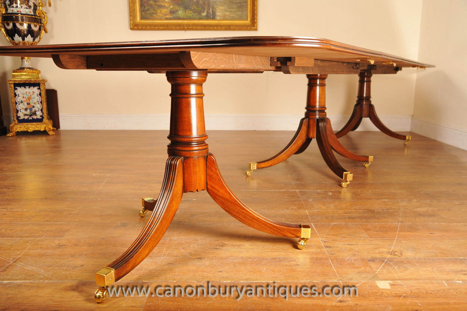 Side view of a classic Regency triple pedestal table