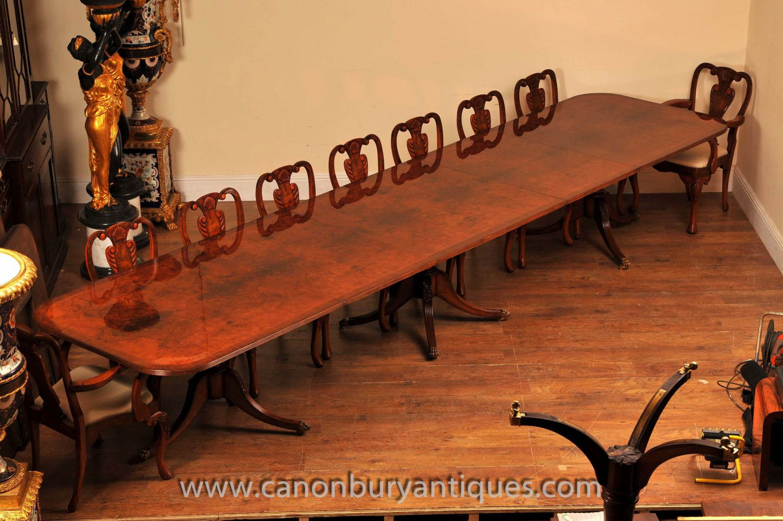 Large Regency table in walnut with matching Queen Anne chairs