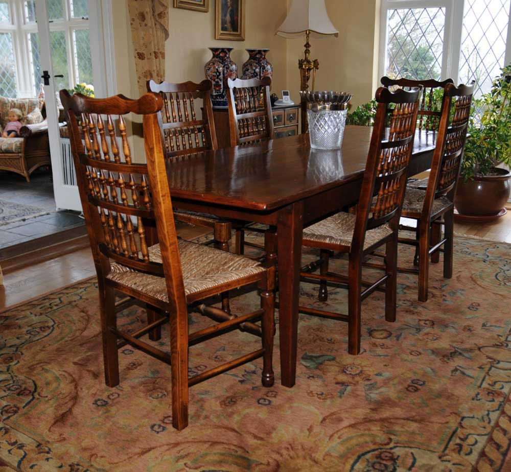 Set of spindle back chairs around the trusty refectory table