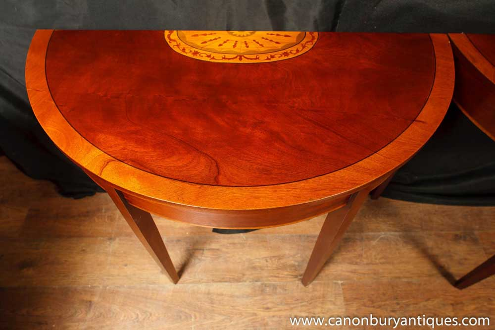 The distinctive half round / half moon shape on this flame mahogany table