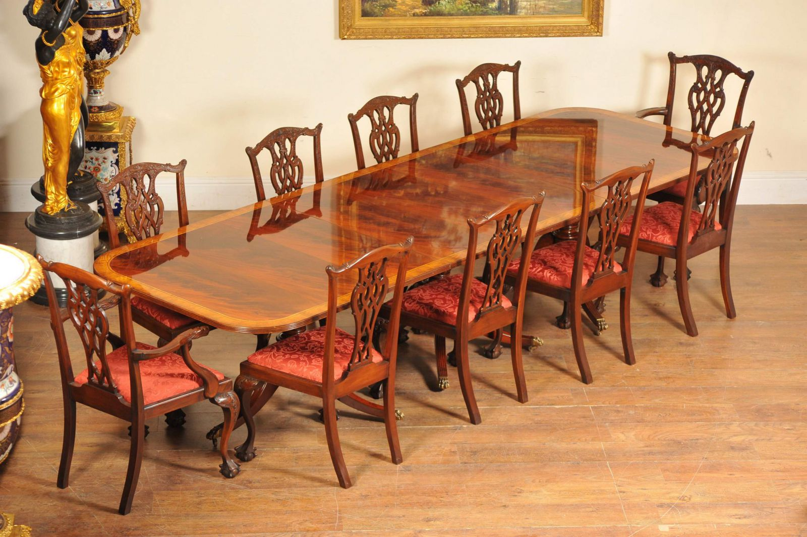 Flame mahogany Regency table and matching set of Chippendale chairs