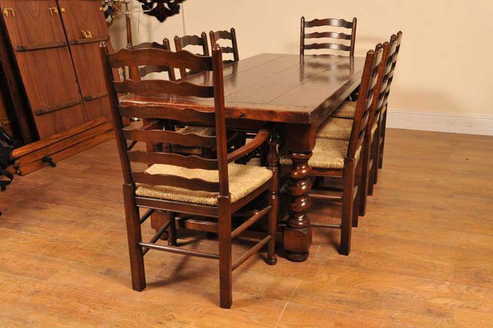 Set of ladderback chairs around this large oak refectory table