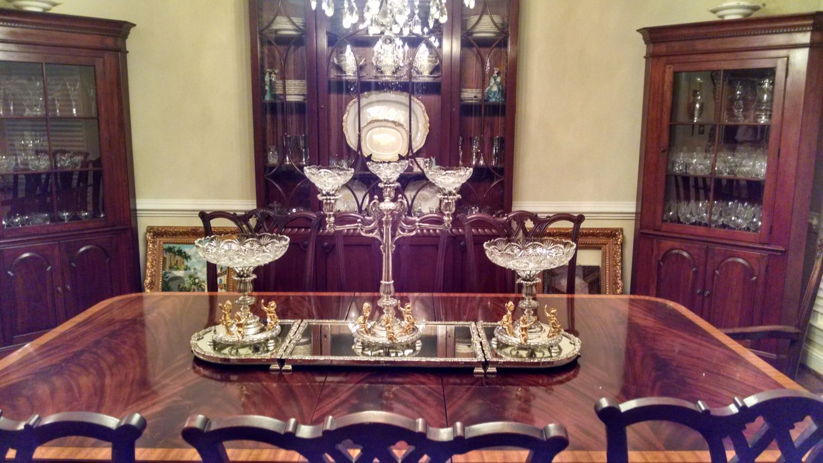 Silver plate epergne in it s correct position on a classic dining table. This one is in Berkshire, England...