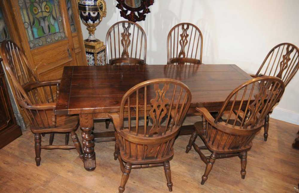Set Windsor Chairs around the oak refectory table with barley twist legs