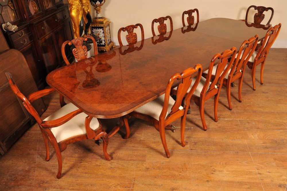 Queen anne chairs around a walnut regency pedestal table